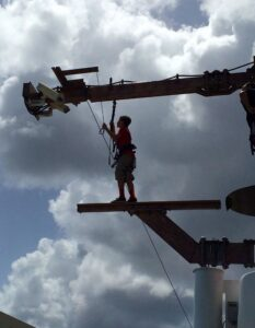 My son walking the plank over the side of the Norwegian Getaway