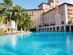 Imagine old Miami luxury while lounging at the large resort pool in the US